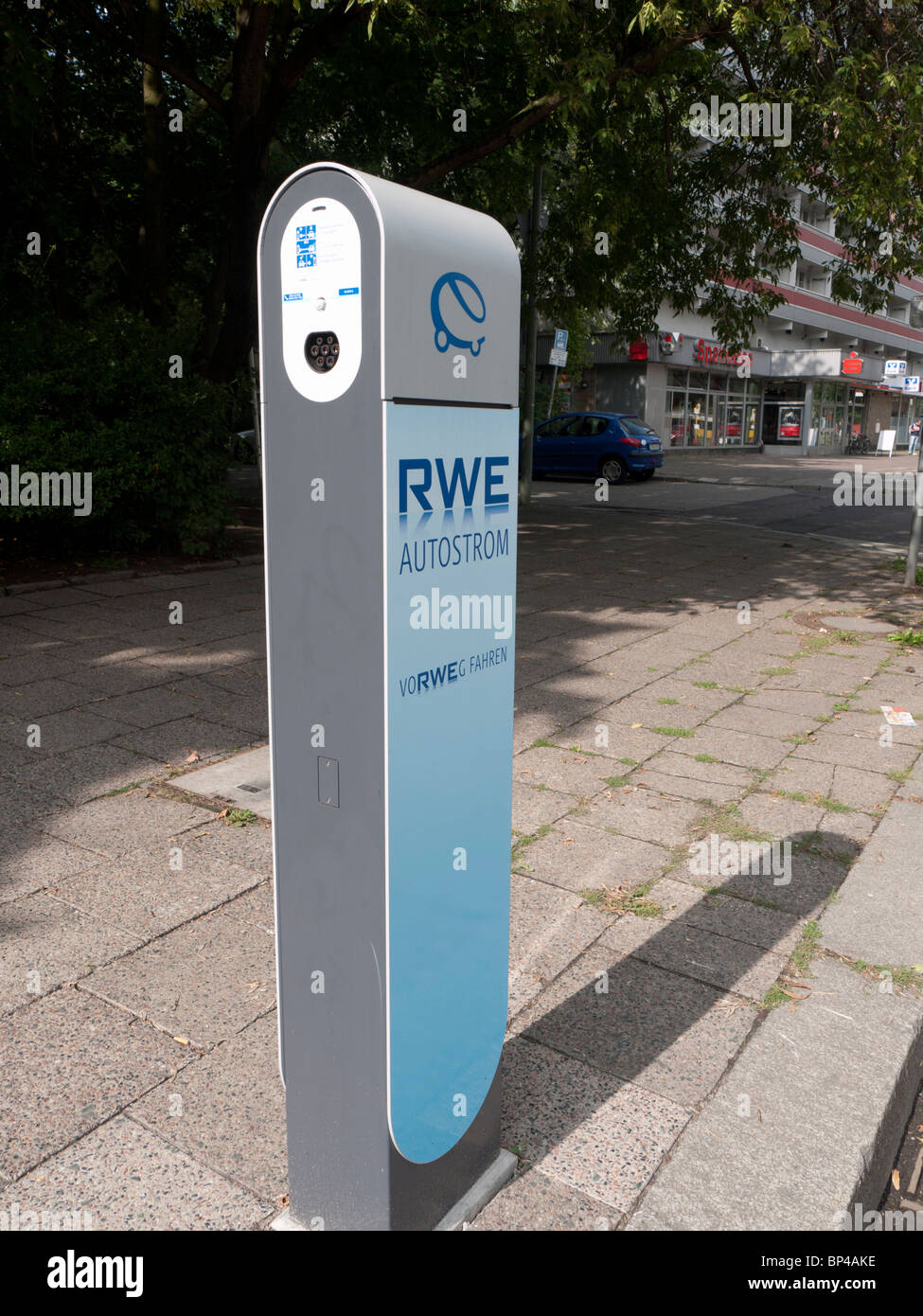 New electric car plug-in recharging station operated by RWE on Berlin street Germany - Stock Image