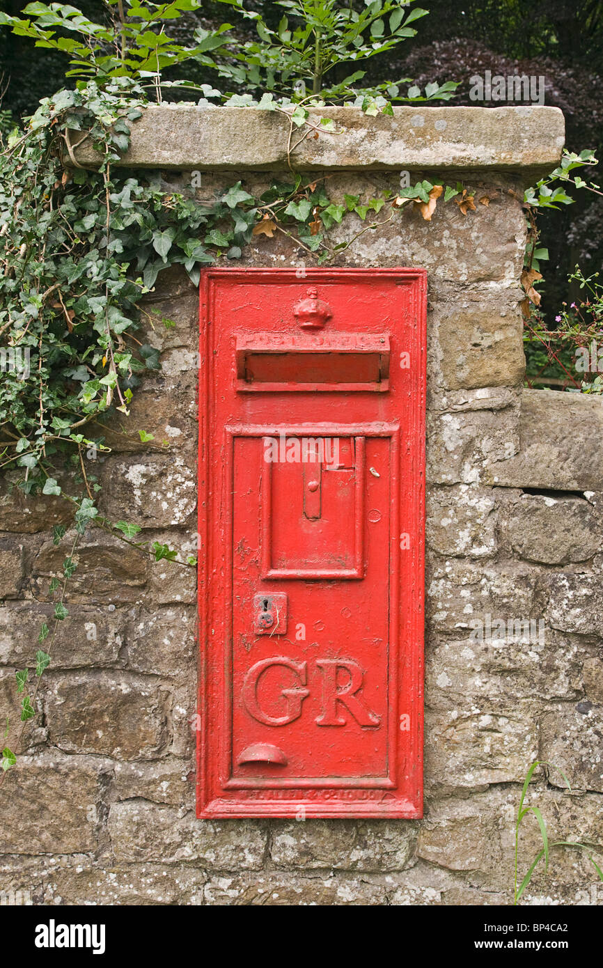 A rural postbox decommissioned and blocked up. - Stock Image