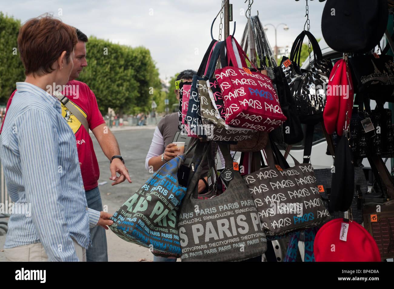 Paris, France, Tourist Couple near Eiffel Tower, Buying Souvenir Bags Stock Photo