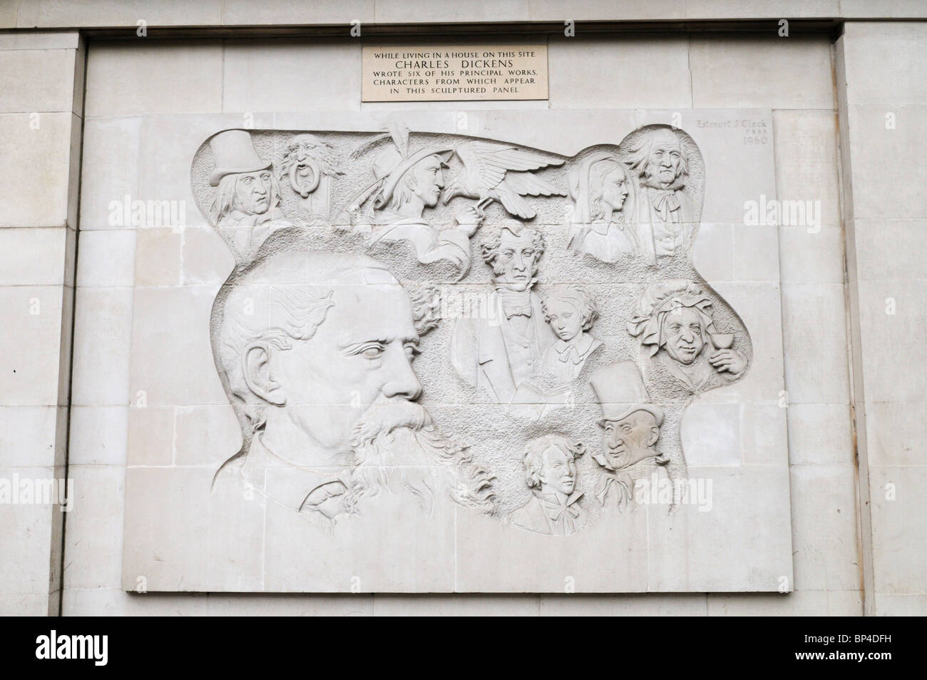 Bas Relief carving sculpture of Charles Dickens Characters, Marylebone Road, London, England, UK - Stock Image