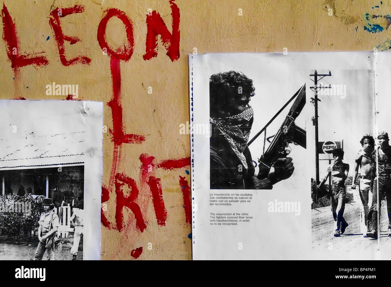 A revolutionary writing together with historical photos on the wall of the Sandinista museum in Leon, Nicaragua. - Stock Image