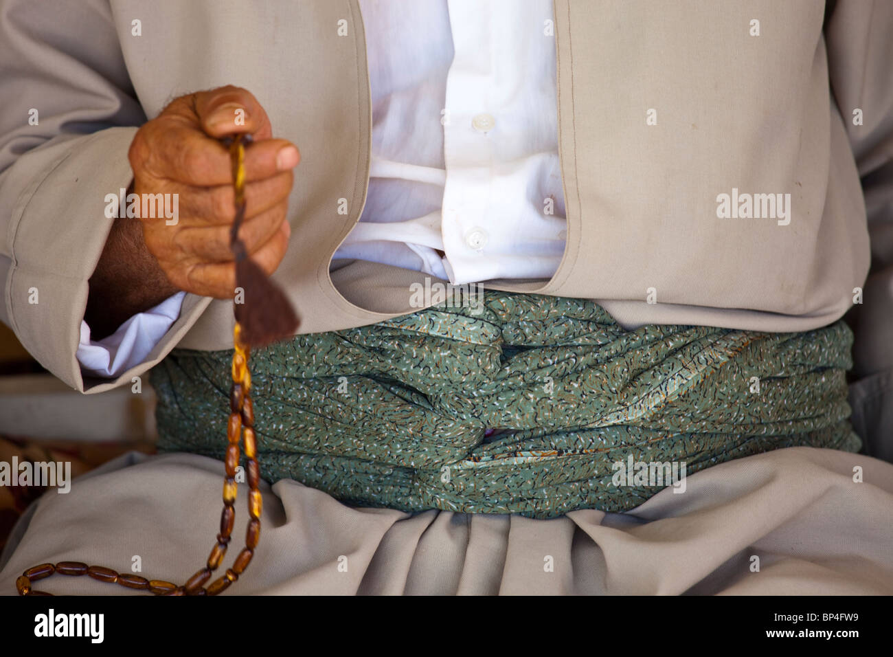 Kurdish Iraqi man counting Muslim prayer beads in Dohuk, Kurdistan, Iraq - Stock Image