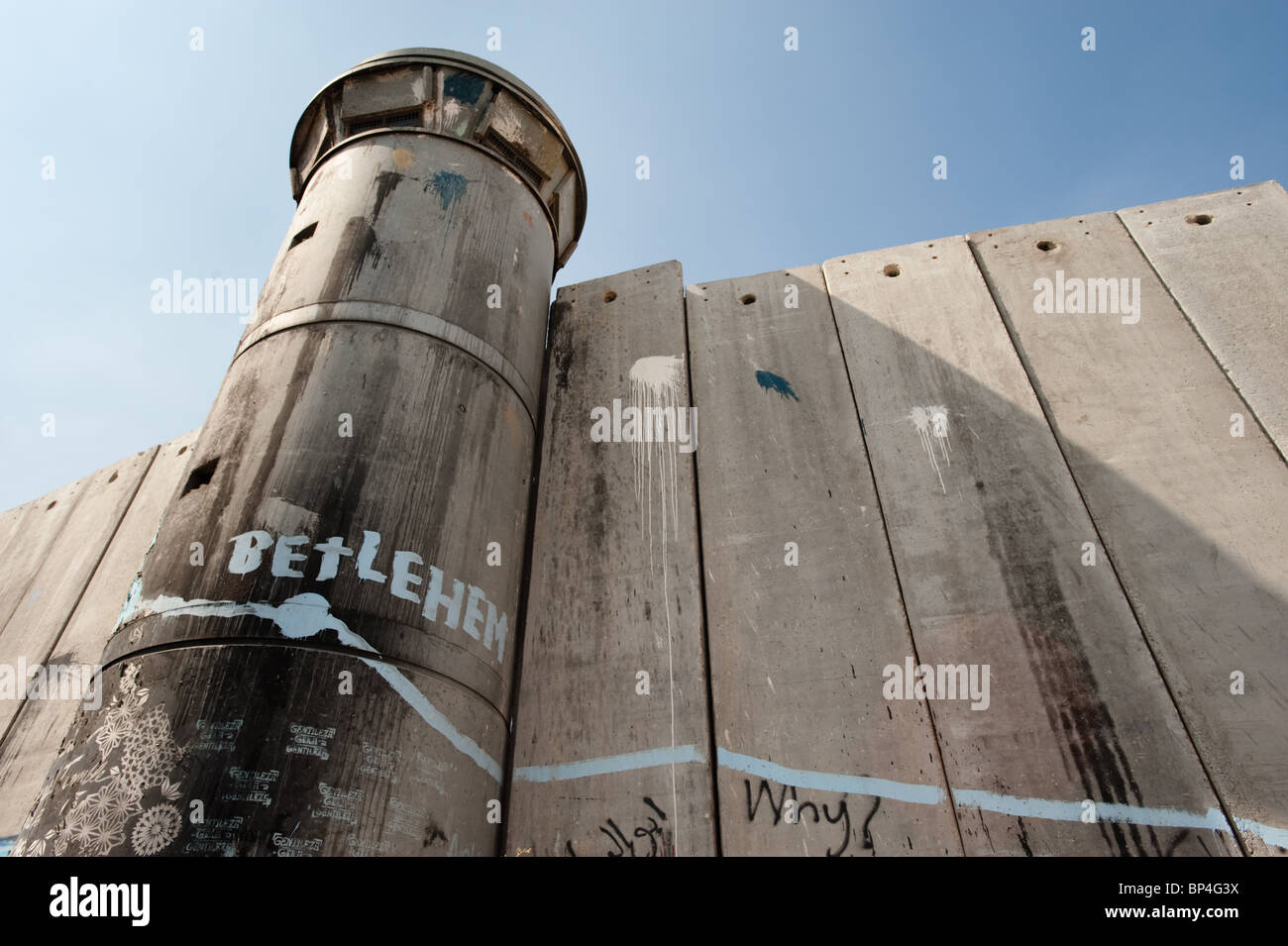 Activist graffiti adorns the Israeli separation wall in the West Bank town of Bethlehem. - Stock Image