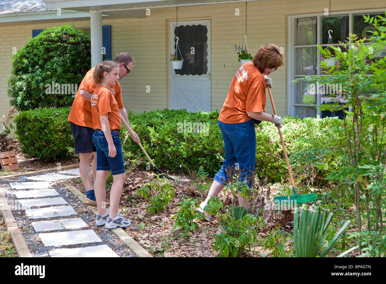 Members of First Baptist Church provide community service during Be The Church outreach project in Ocala, Florida - Stock Image