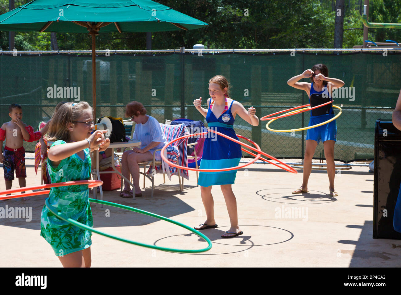 Walt Disney World, FL - May 2009 - Girls compete in hula-hoop contest at Walt Disney's Fort Wilderness Resort - Stock Image