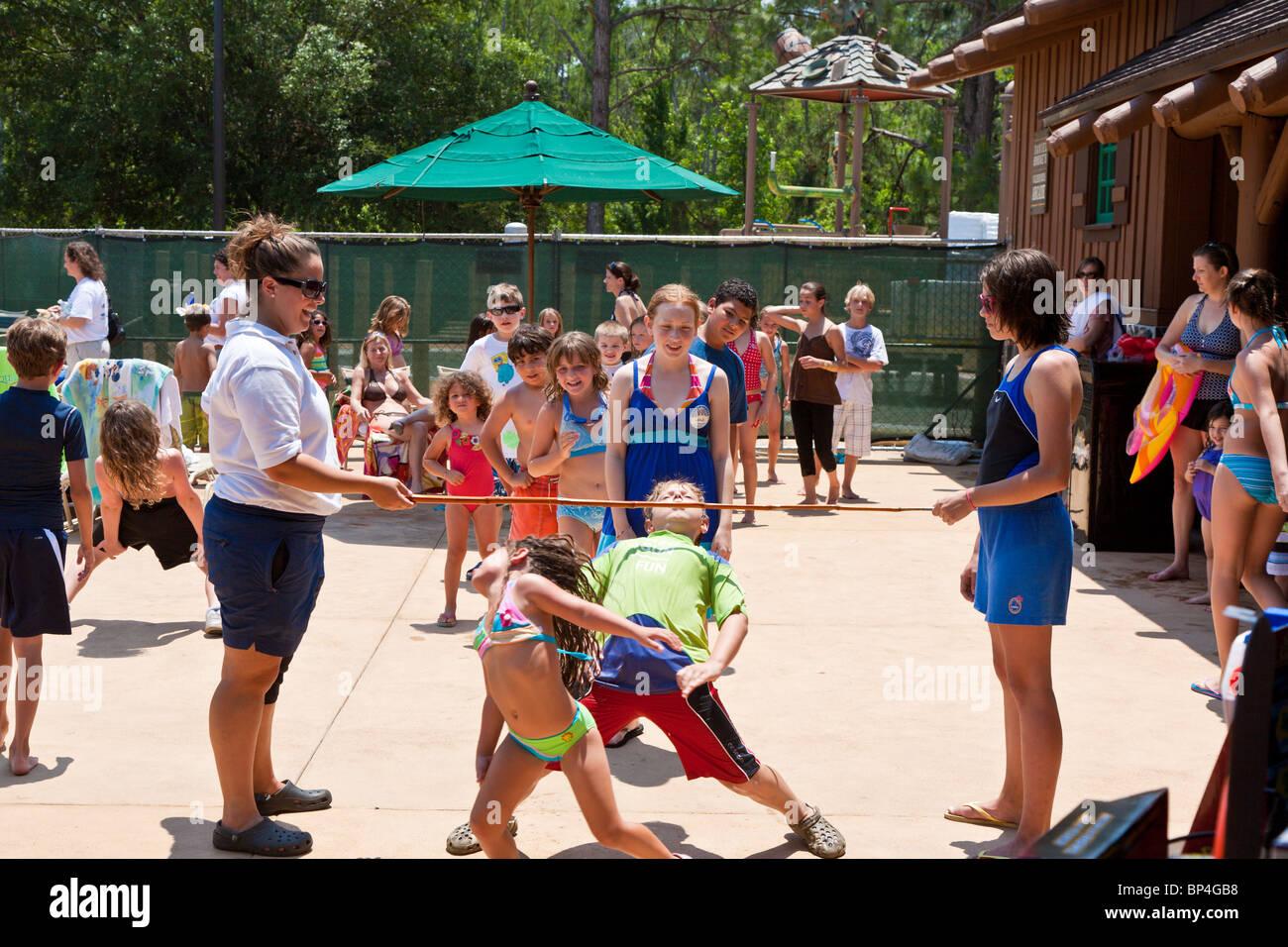 Walt Disney World, FL - May 2009 - Children compete in Limbo contest at Walt Disney's Fort Wilderness Resort - Stock Image