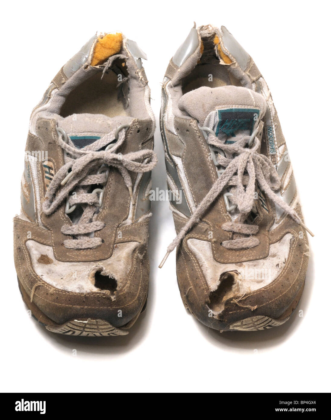 Worn out trainers - Stock Image