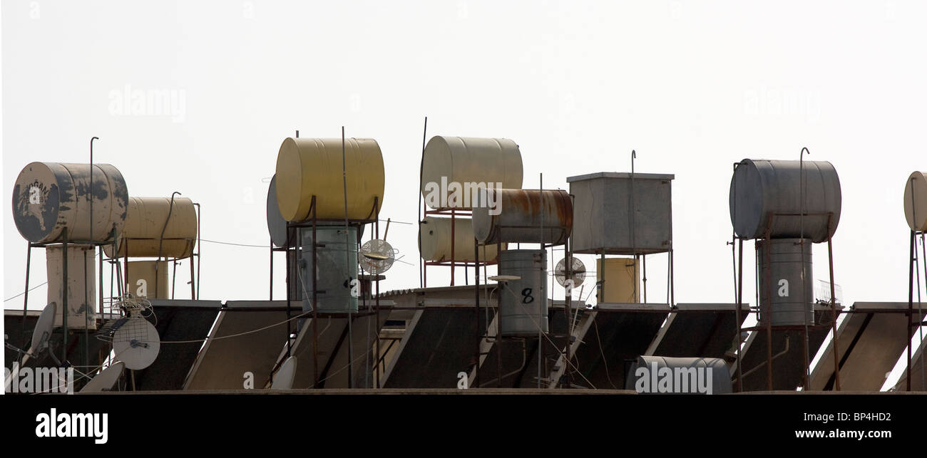 Barrels and solar panels on rooftop, Alanya, Turkey. Stock Photo