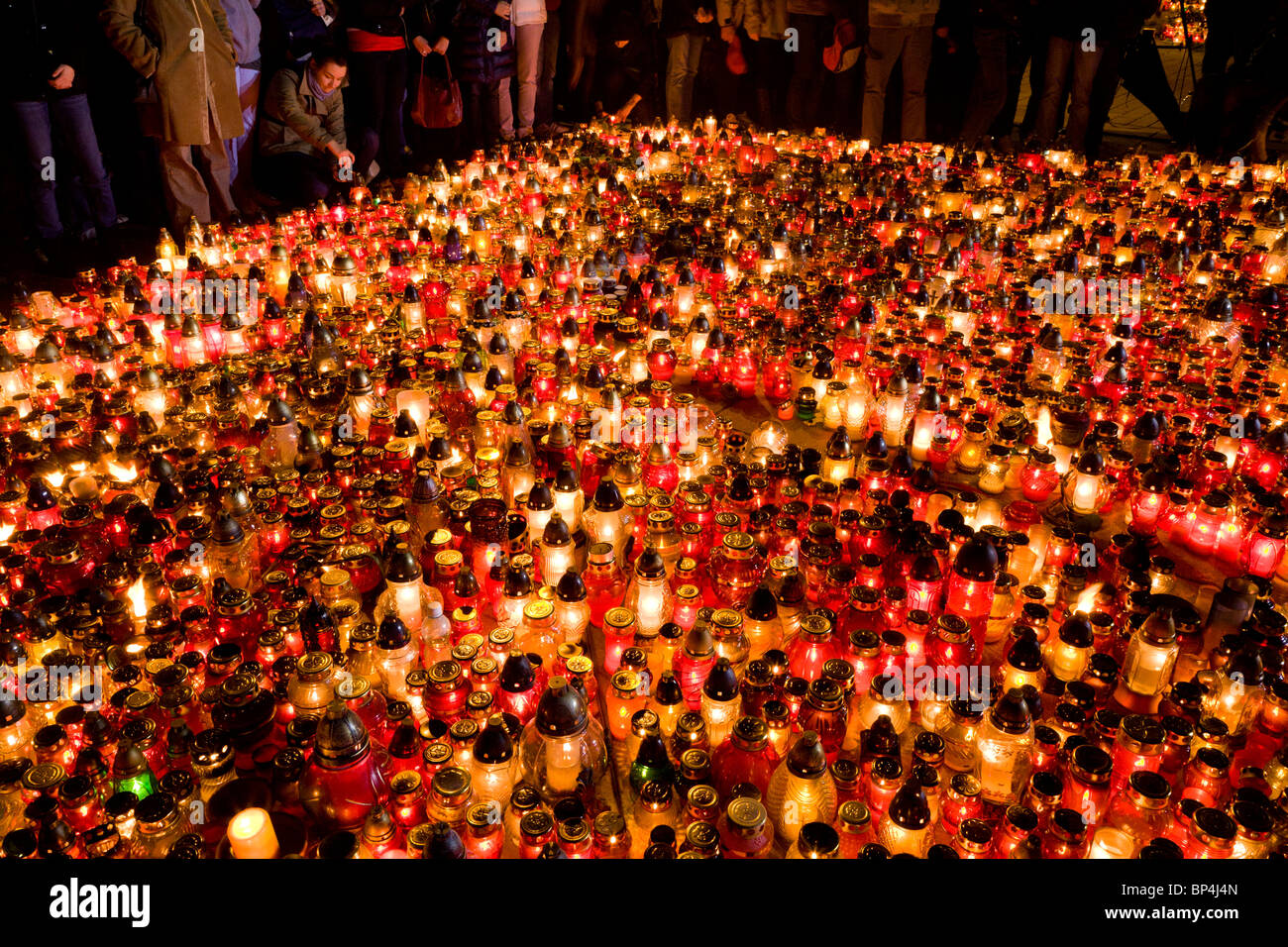 Warsaw Poland: People gather at the Presidential Palace in memory of president Lech Kaczynski and 95 others... Stock Photo