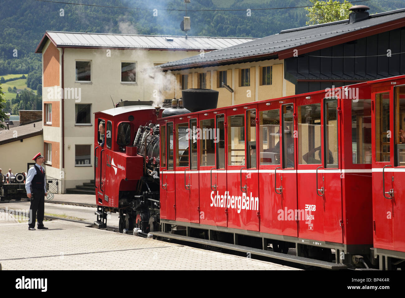 St Wolfgang, Salzkammergut, Austria. Red steam train on rack and pinion railway station platform to Schafberg mountain Stock Photo