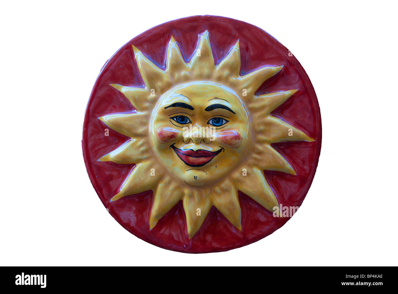 Ceramic adornment Red sun smiles - Stock Image