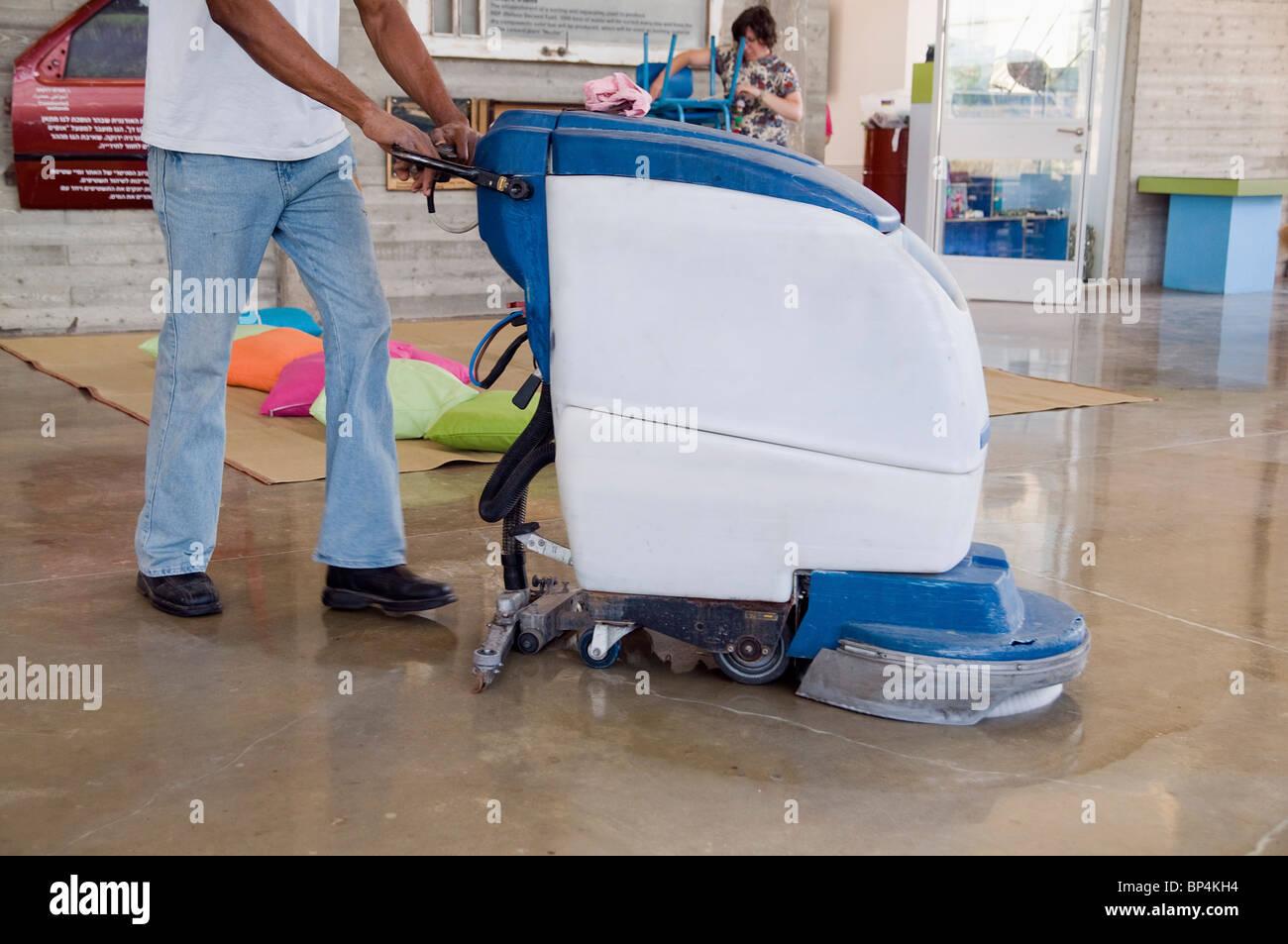 Man Operates A Floor Sweeper Vacuum Machine Stock Photo 30835984