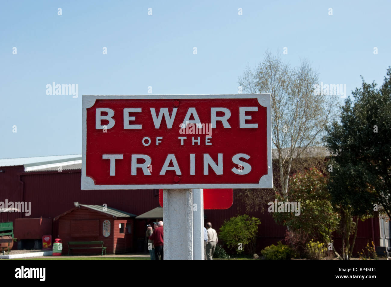 Beware of the trains sign - Stock Image