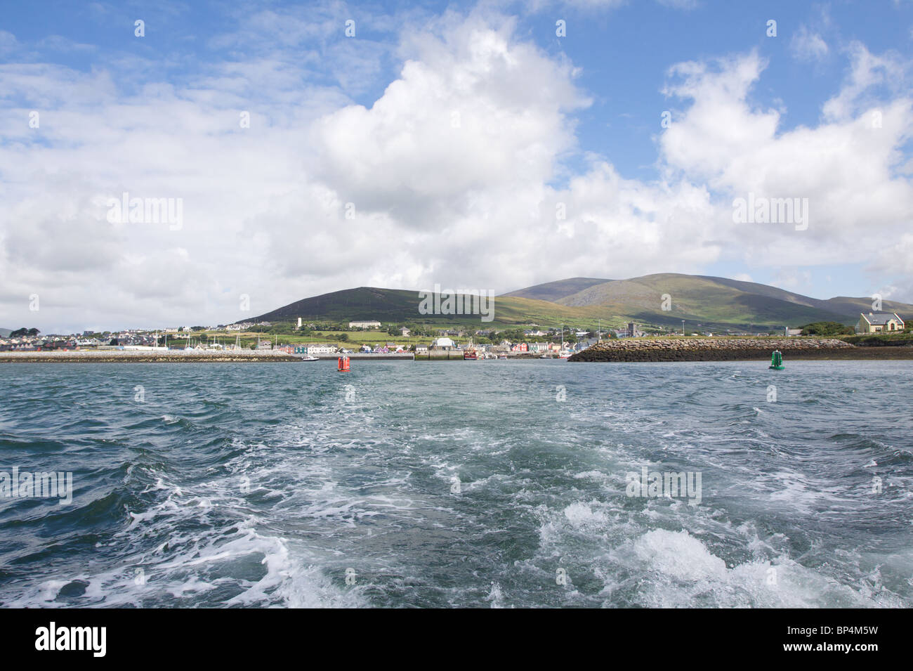 Waves from a boat leaving Dingle harbour, County Kerry in Republic of Ireland - Stock Image