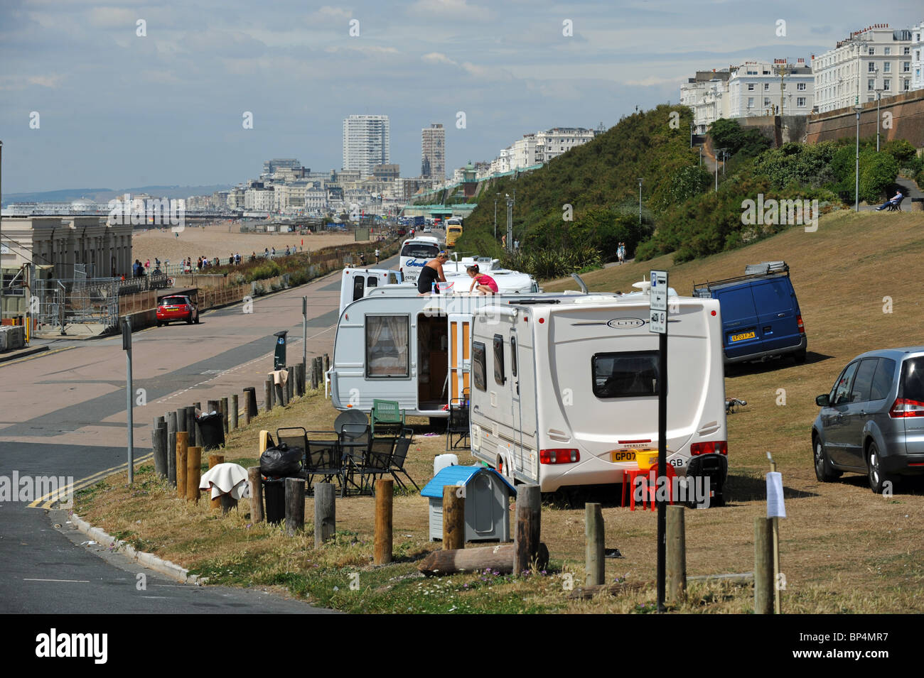 Travellers parked up by Dukes Mound near Brighton Marina UK - Stock Image