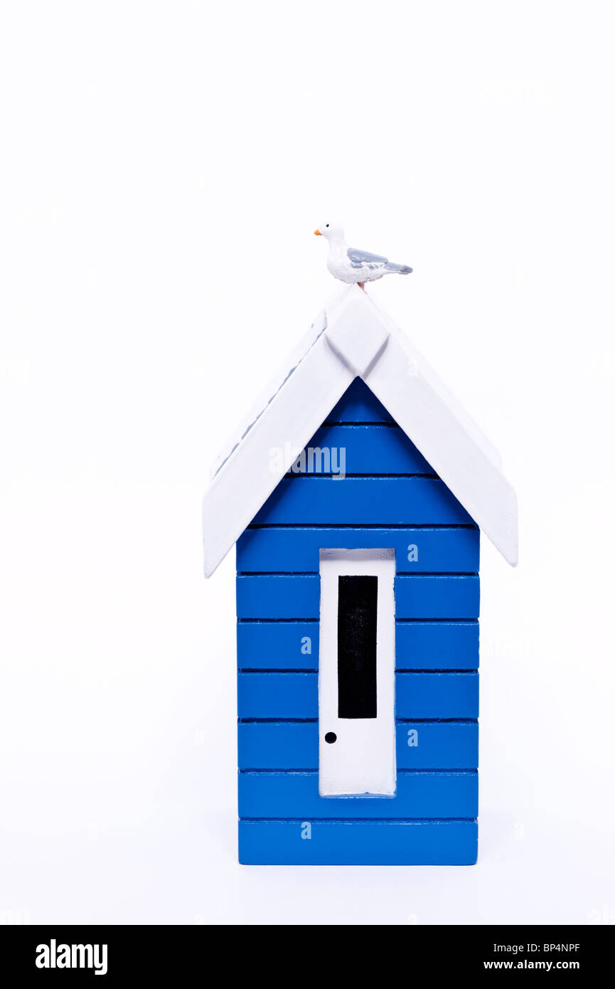 A cut out of a beach hut with copy space on a white background - Stock Image