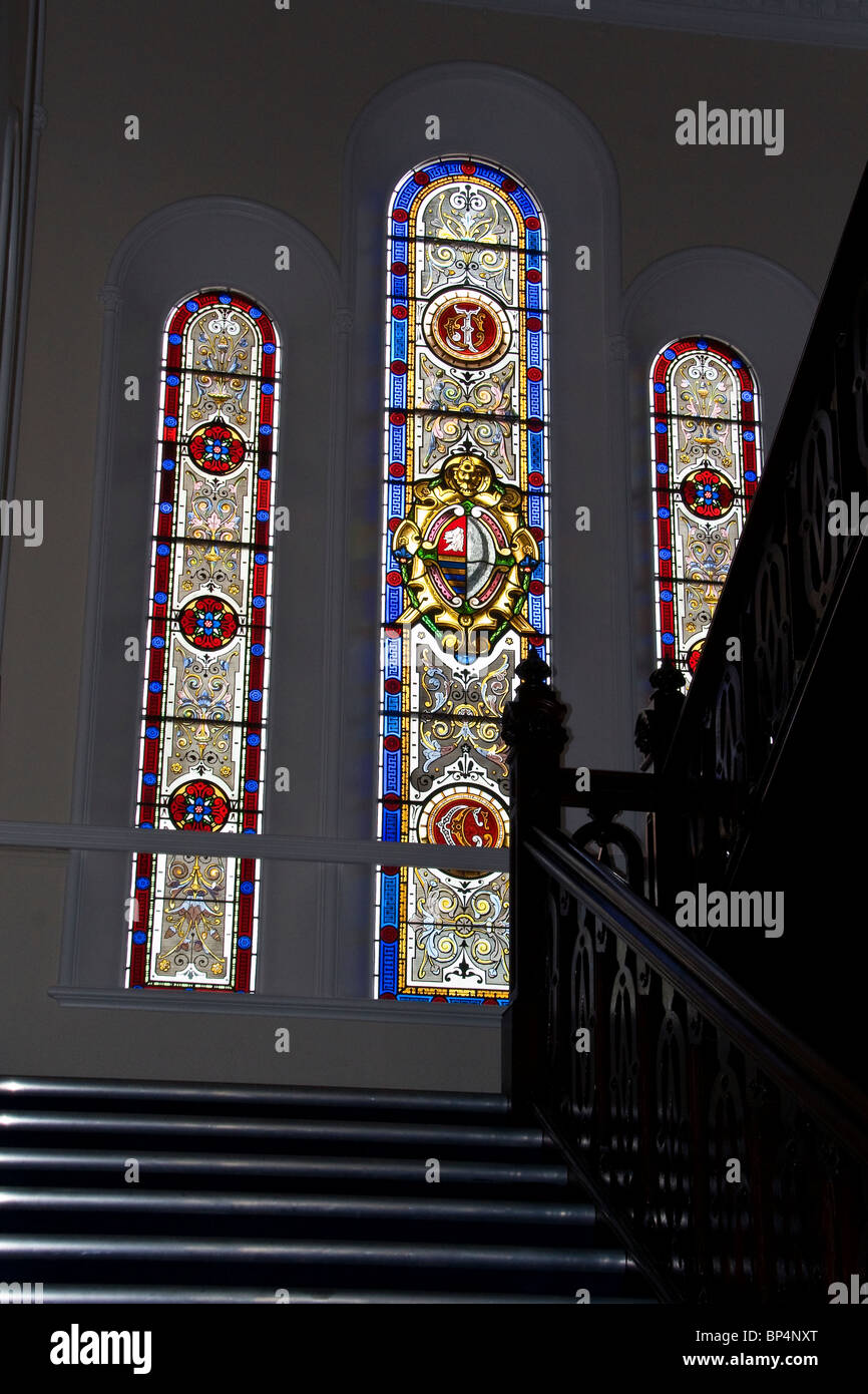 Three arched etched glass windows at the top of the stairway of  Clement Park House in Dundee,UK - Stock Image