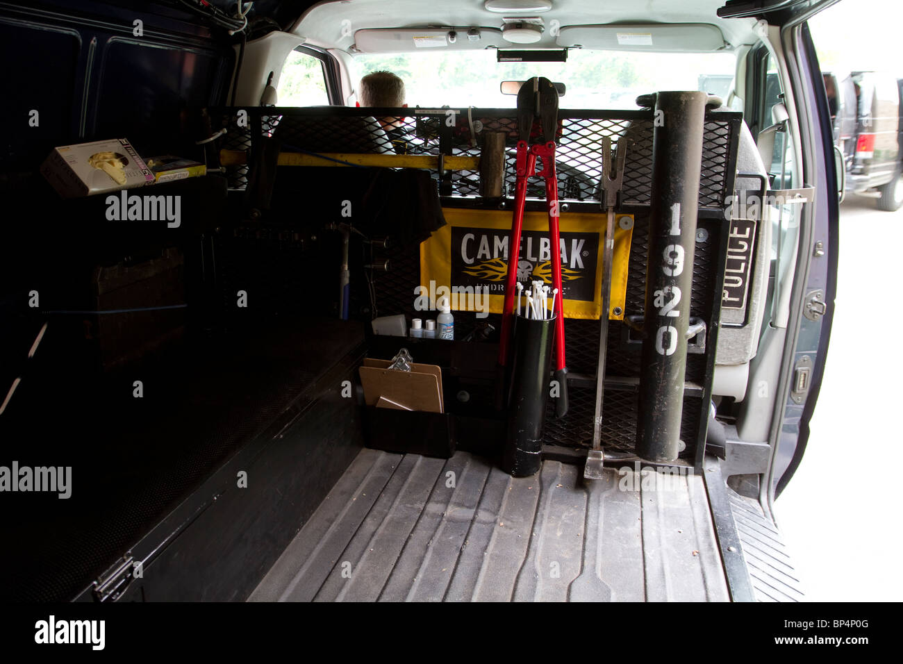 Inside police swat van. Entry tools. Bolt cutters, battering ram, flexicuffs etc. Street Narcotics Unit. Kansas - Stock Image