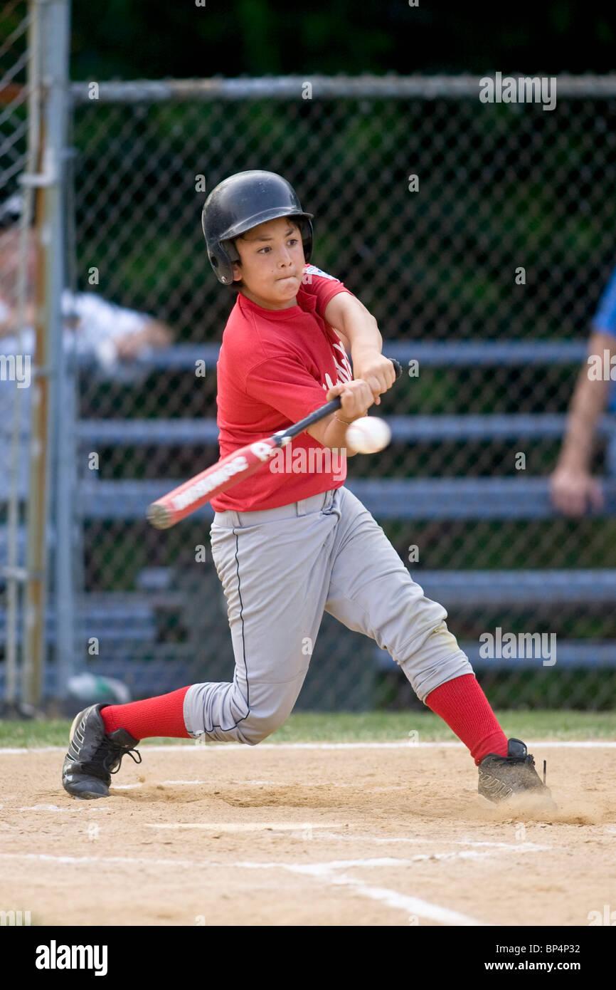 Boys baseball game action. - Stock Image