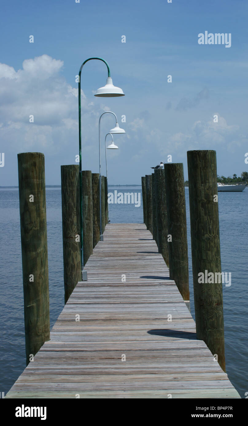 wooden pier with white lights - Stock Image