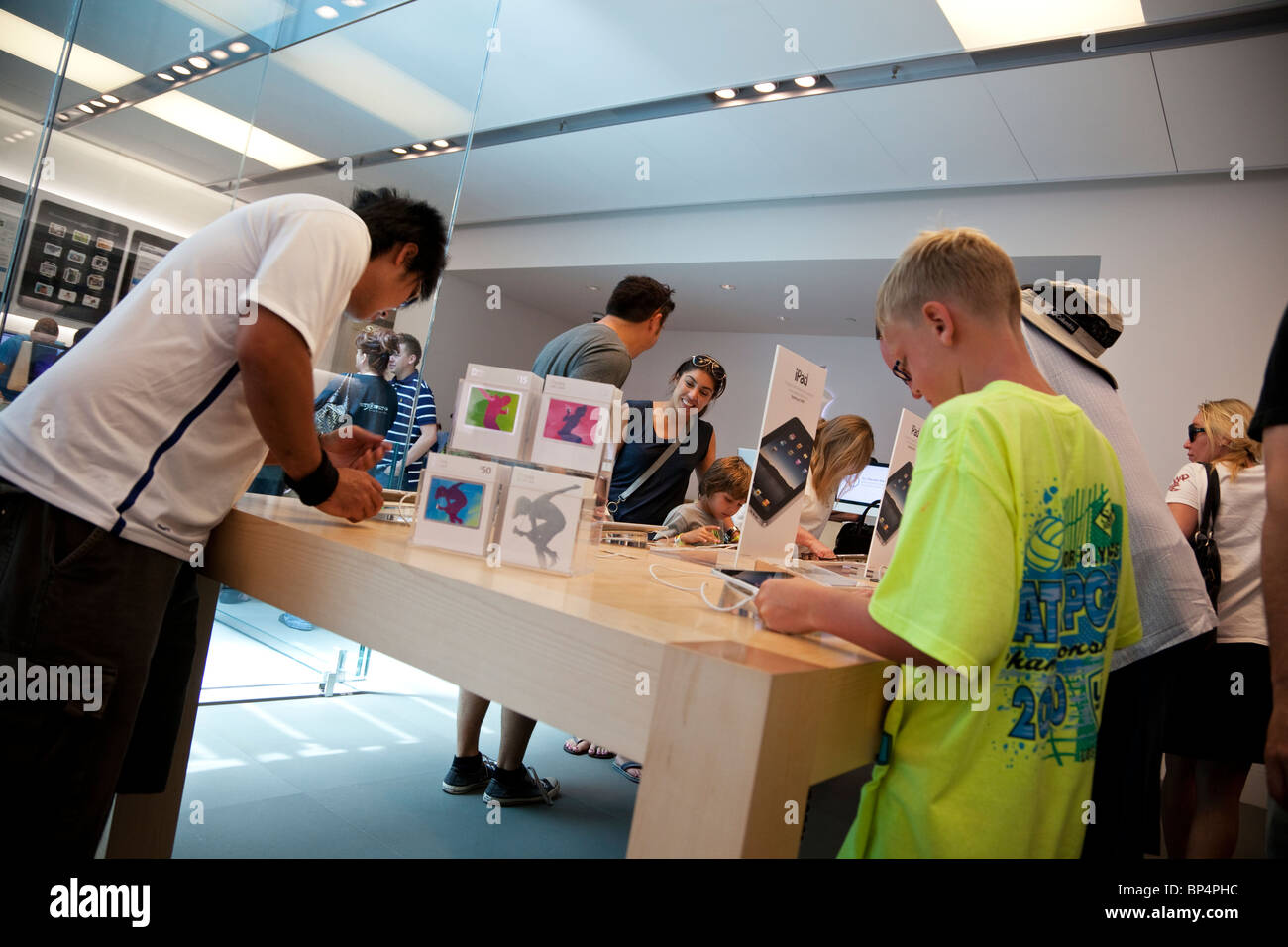 People try out the iPad in an Apple store in Los Angeles, California, USA. - Stock Image