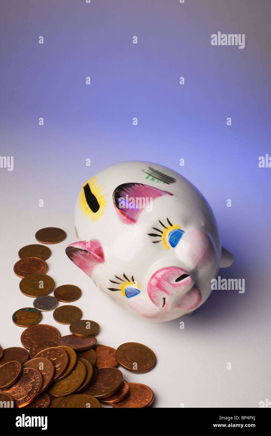 Fallen over Piggy Bank emptied of cash. Stock Photo