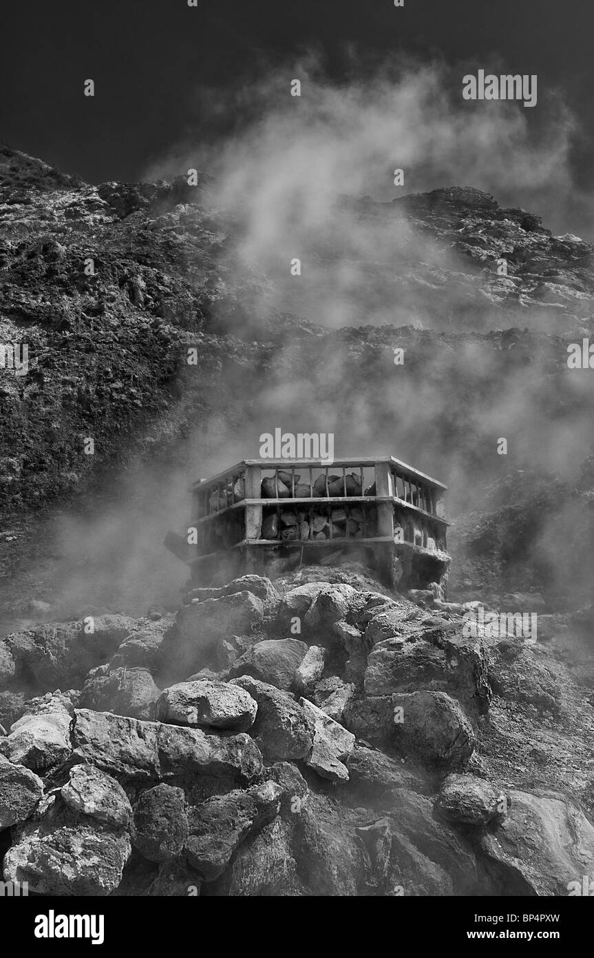 a characteristic b/w picture of solfatara.This volcanic crater is located near Naples and emits fumes of sulfur - Stock Image