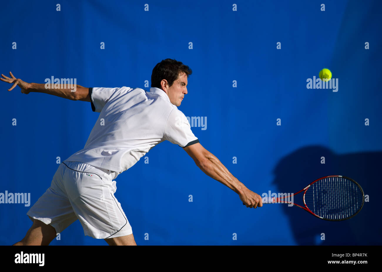 Guillermo Garcia-Lopez of Spain in action against J Benneteau. - Stock Image