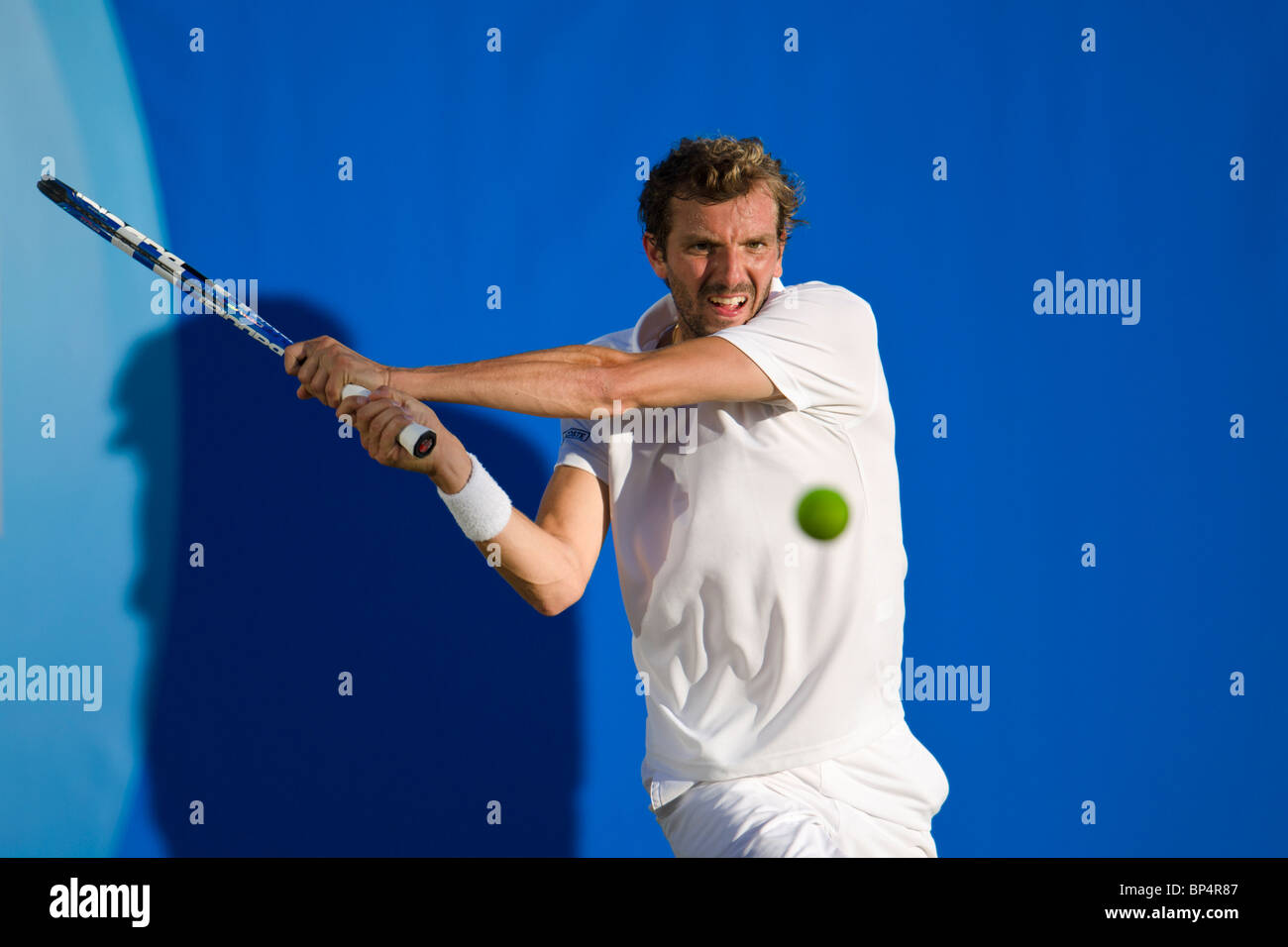 J Benneteau in action against Guillermo Garcia-Lopez of Spain. - Stock Image