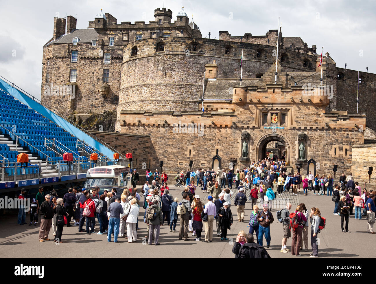 Crowds of tourists in Edinburgh Castle Esplanade, Scotland UK, Great Britain, with seating for the Military Tattoo Stock Photo