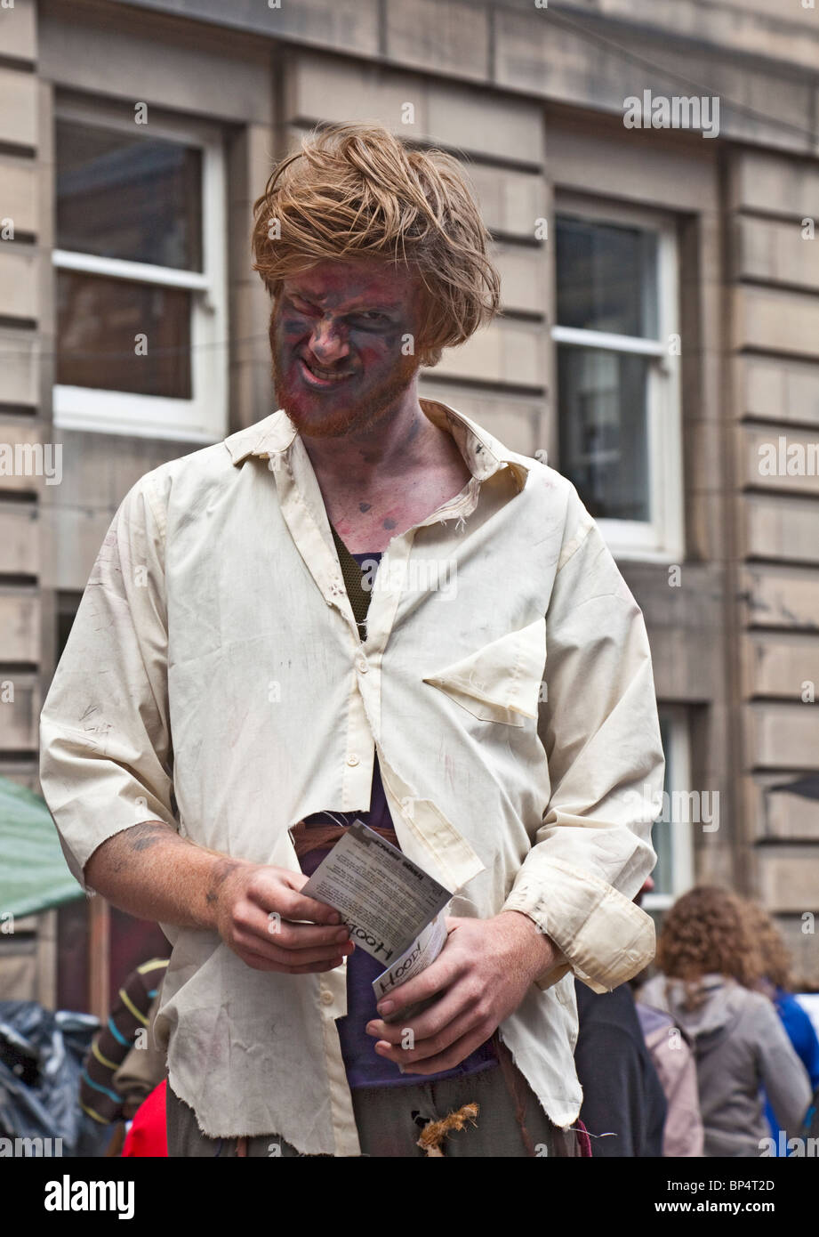 Actor promoting a production of Hood! in the Royal Mile / High Street Edinburgh Festival Fringe. - Stock Image