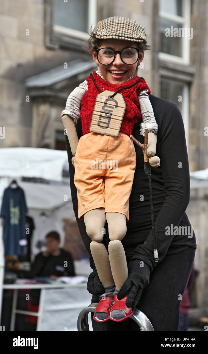Young actress promoting a performance of Kafka's Metamorphosis in the Royal Mile/High Street, Edinburgh Festival - Stock Image