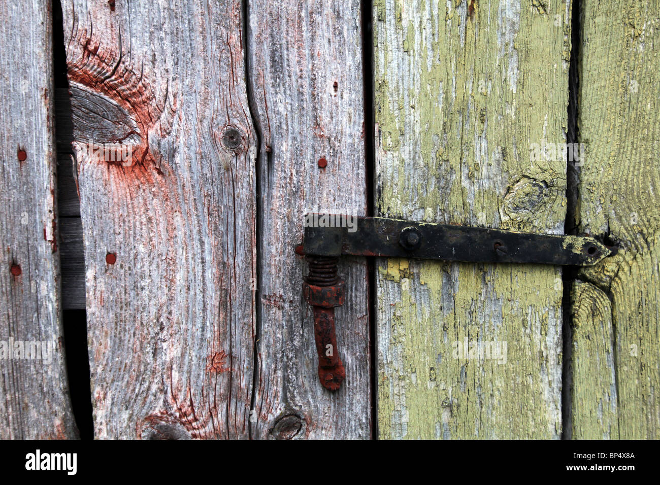 Traditional Nordic shed outhouse with odd shaped door detail flaking old paint Aland archipelago Finland & Traditional Nordic shed outhouse with odd shaped door detail flaking ...