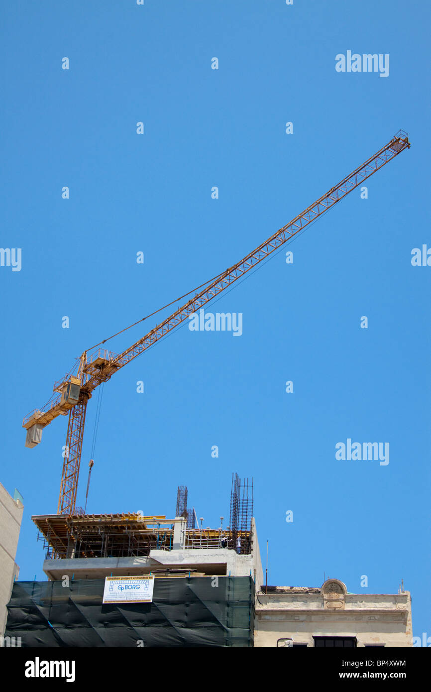 A crane on a construction project, building site, Sliema, Malta - Stock Image