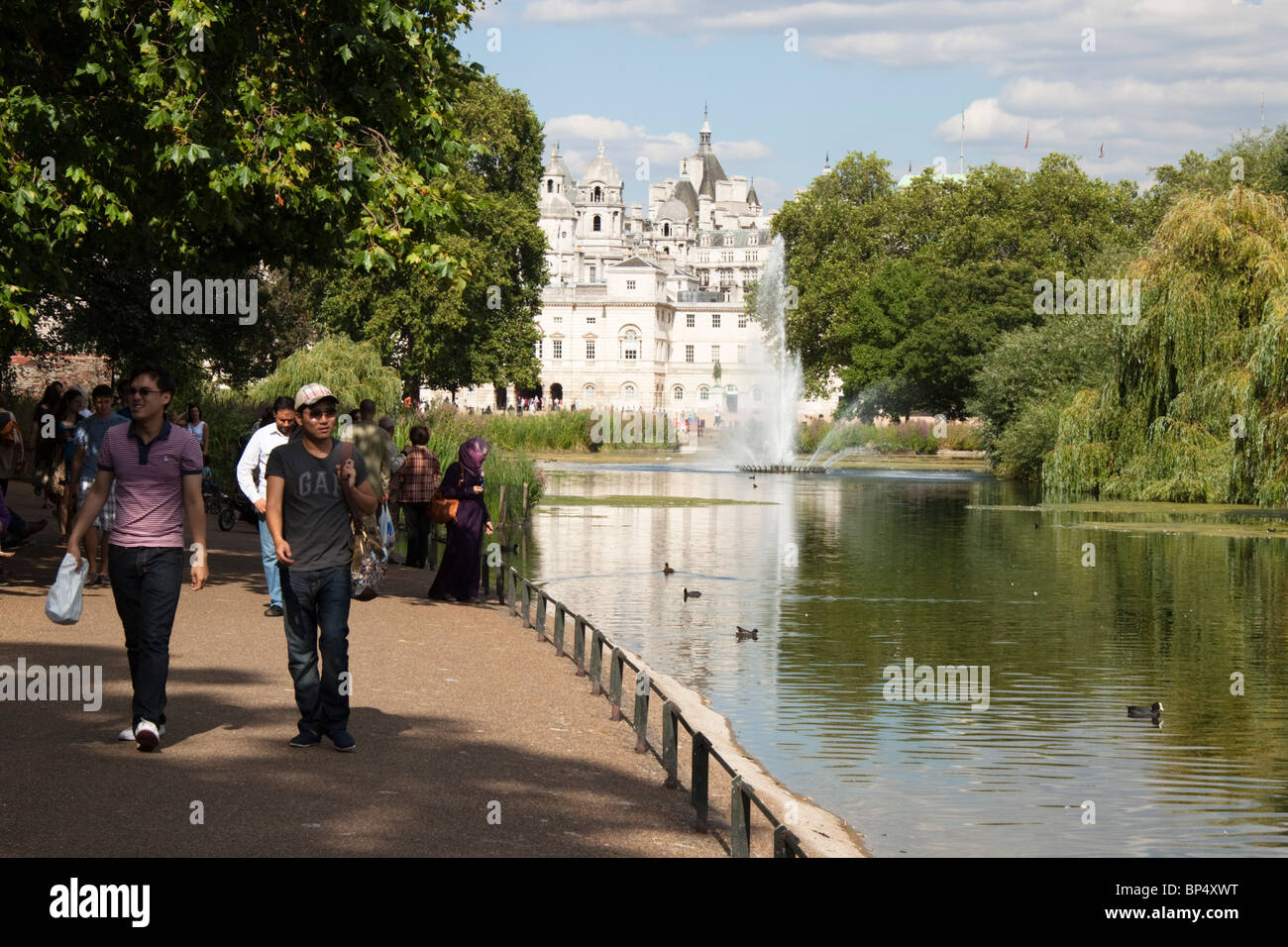 People walking by the lake in St James Park, London, England - Stock Image