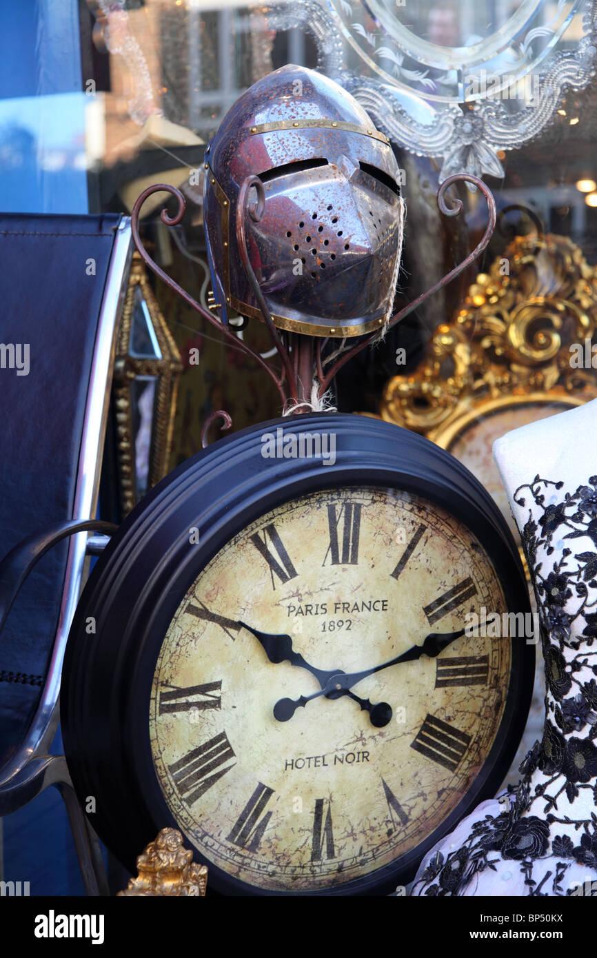 A large clock and bric-a-brac in Portobello Road, Notting Hill, Kensington & Chelsea, London, W11. - Stock Image