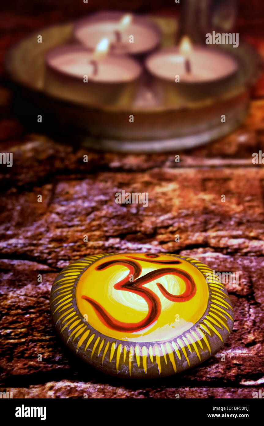 stone with Om or Aum symbol - Stock Image