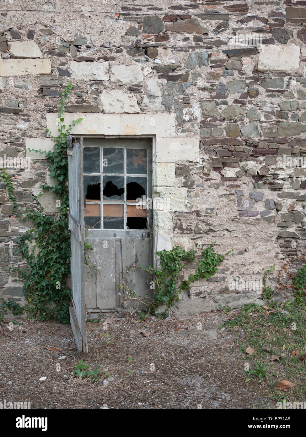 Old disused door in France, Loire region. - Stock Image