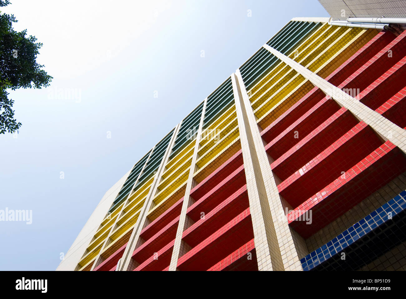 Colorful modern building extend to blue sky. - Stock Image