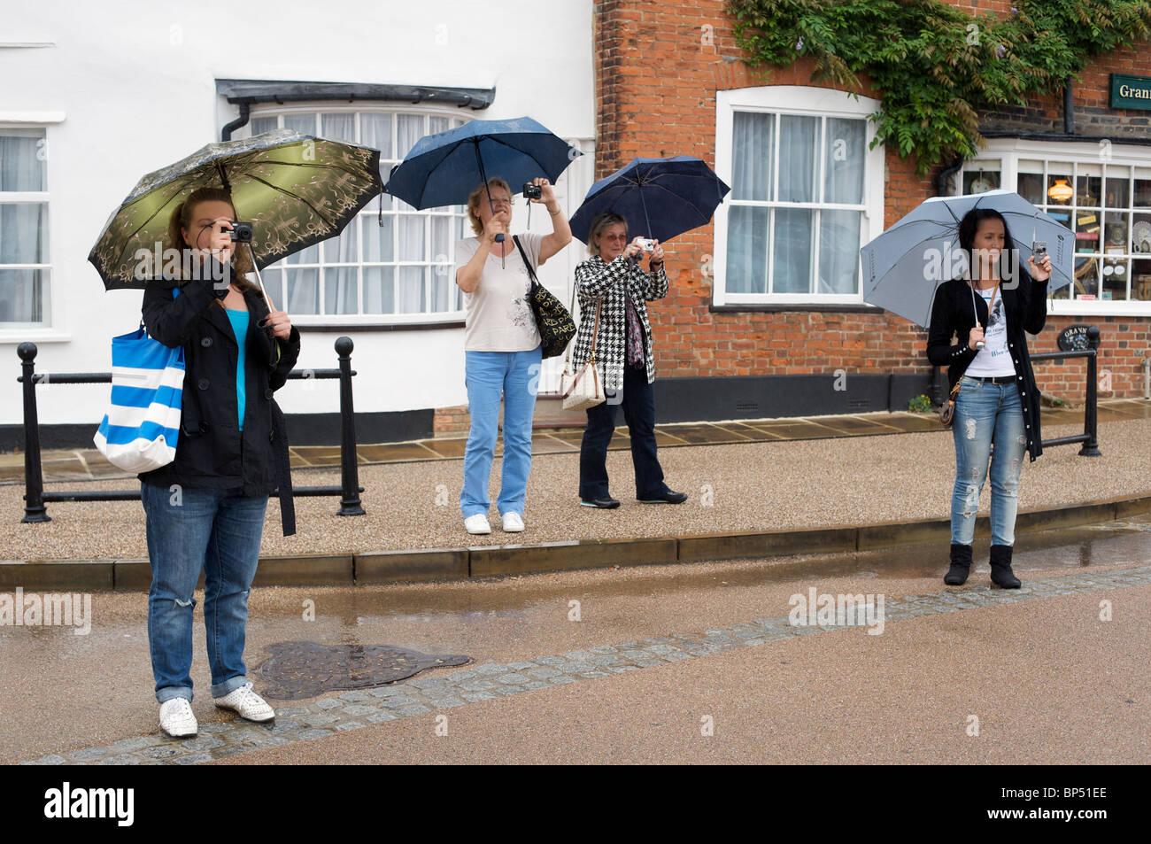 Russian tourists, Lavenham, Suffolk, UK. - Stock Image