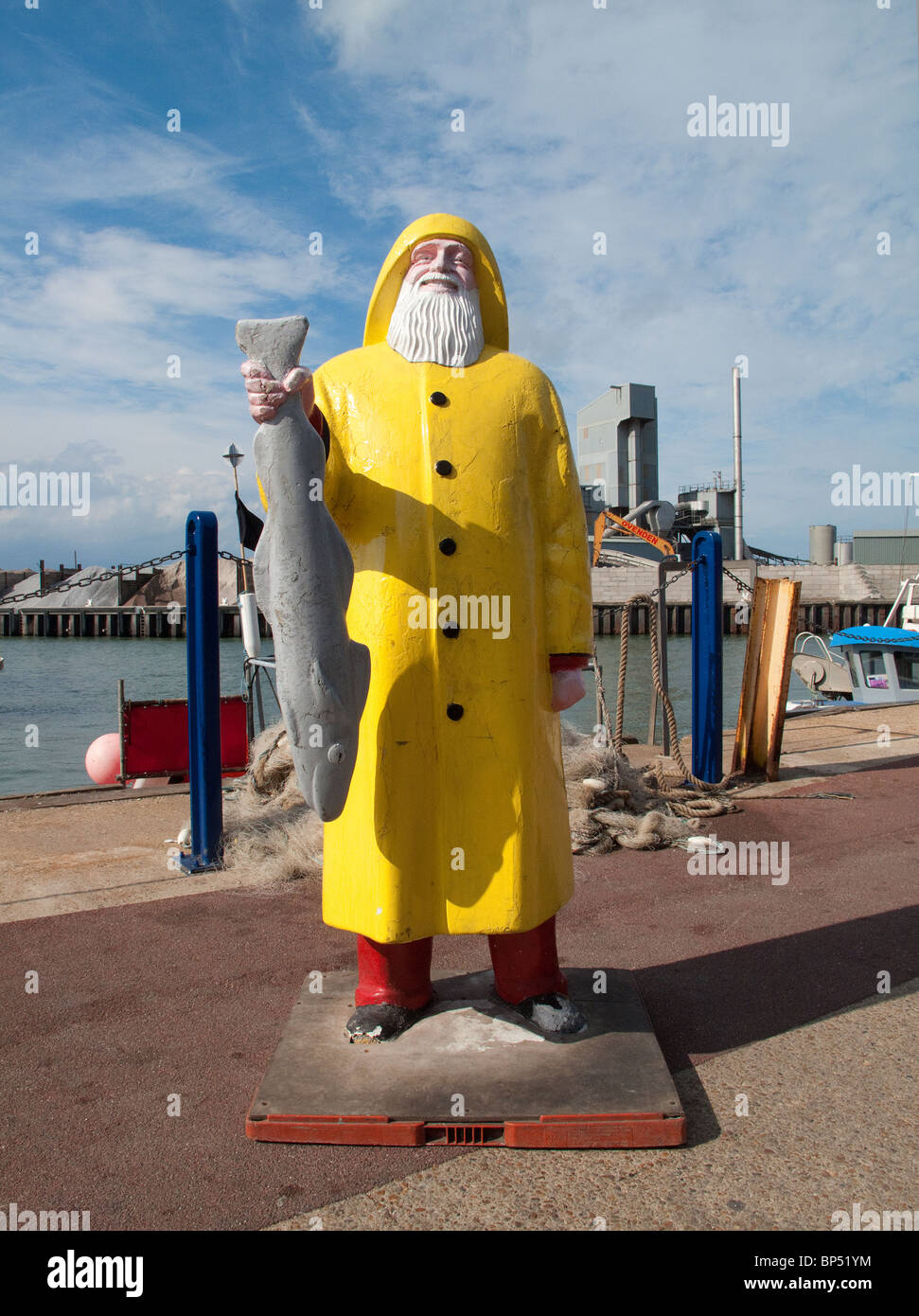 Fisherman figure on quayside at Whitstable, Kent - Stock Image