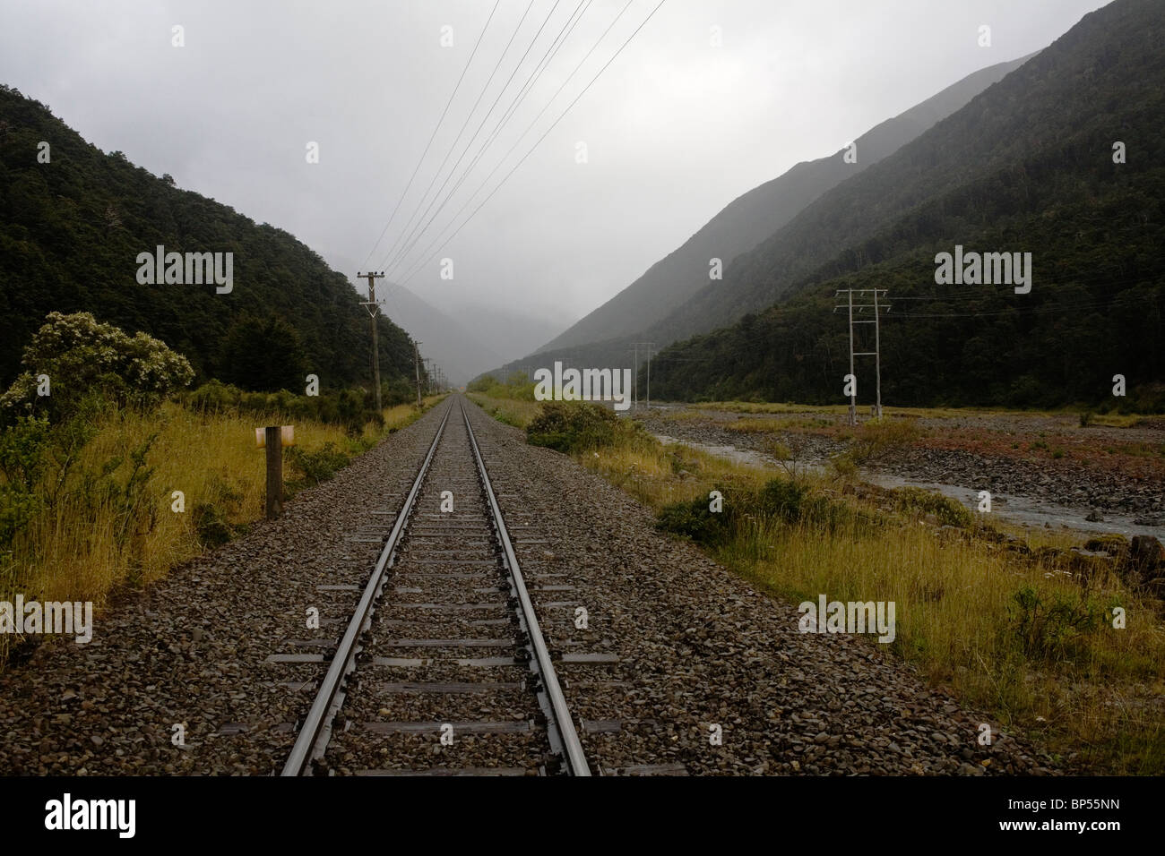 The TranzAlpine railway line going through Arthur's Pass in New Zealand's South Island. - Stock Image