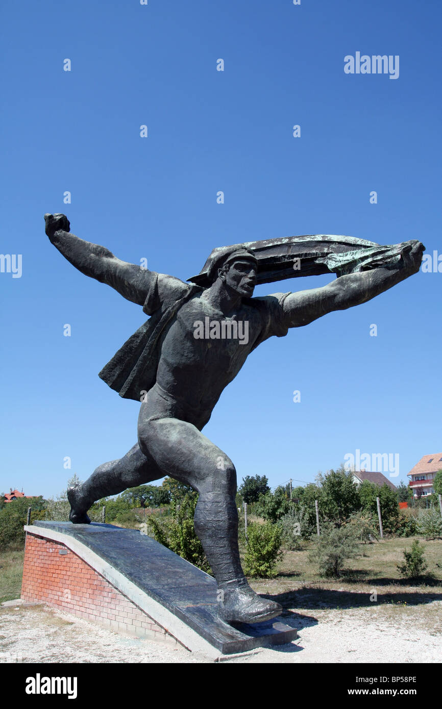 Old Soviet era statue in Memento Park near Budapest. Hungary - Stock Image