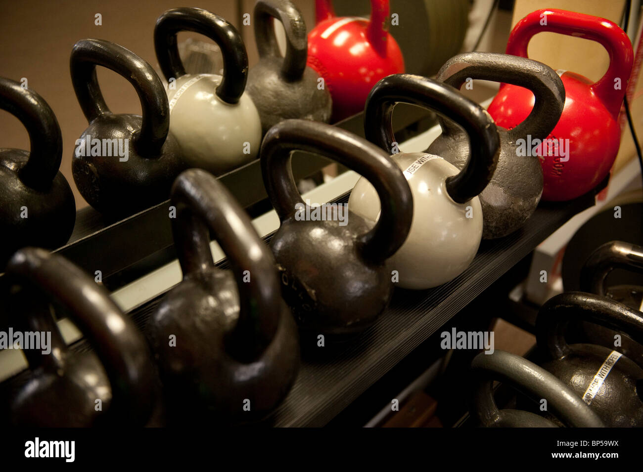 Kettlebell weights on a rack in a gym - Stock Image