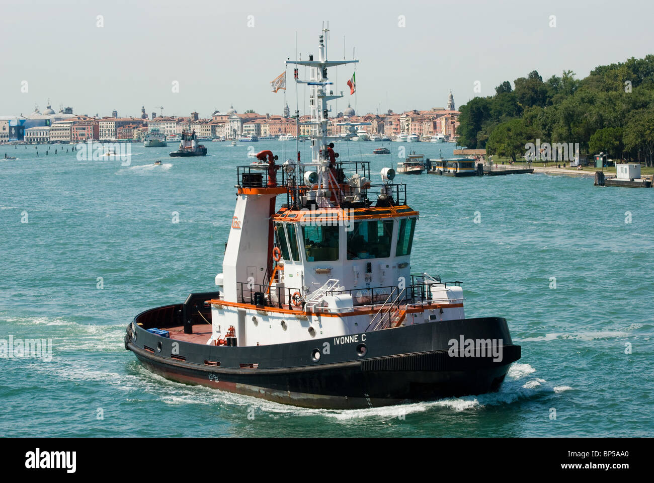 Tugboat on Canale della Giudecca, the approach to Venice, Italy near Lido di Venezia.. - Stock Image
