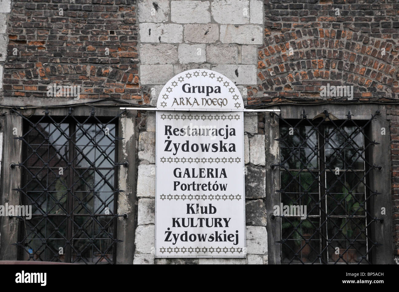 Marble desk with list of mane institution, establishment of old town square, Kazimierz, Poland, Europe - Stock Image