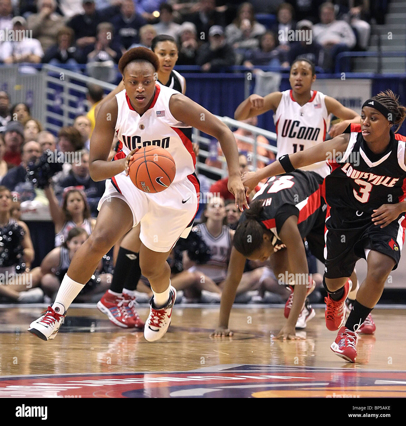Game action of UCONN woman's basketball against Louisville. Both are the top rated women's basketball teams - Stock Image