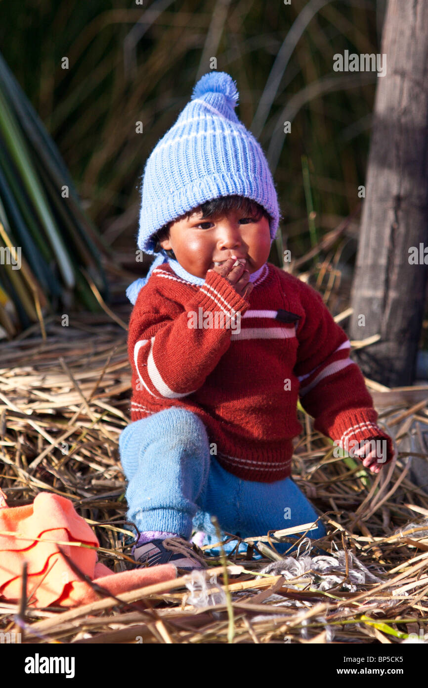 A portrait of a boy of the Uro people from the Floating Islands of the Peruvian part of the Lake Titicaca. - Stock Image