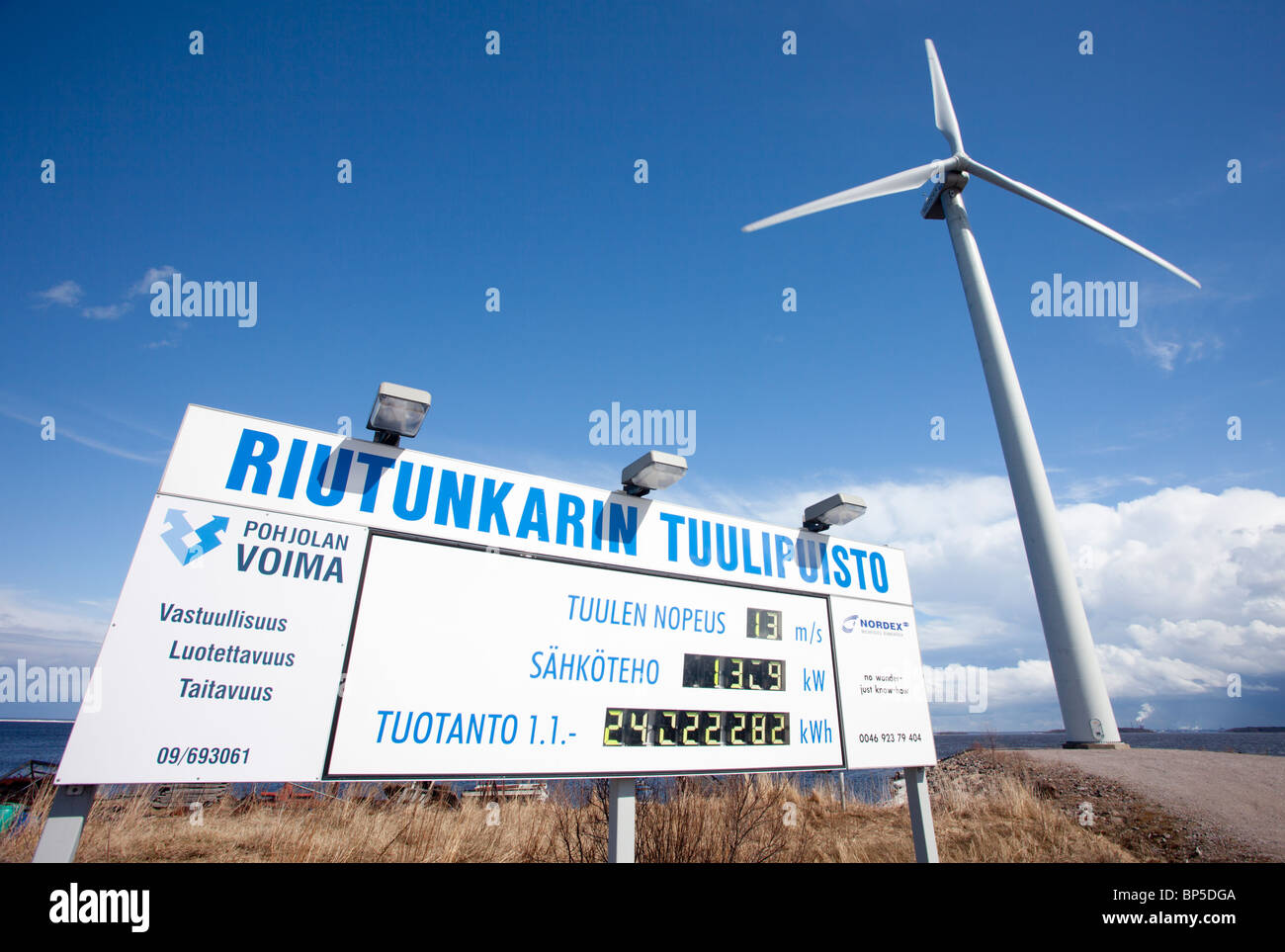 Riutunkari wind farm information board telling the real-time electricity production figures and wind turbine , Finland - Stock Image