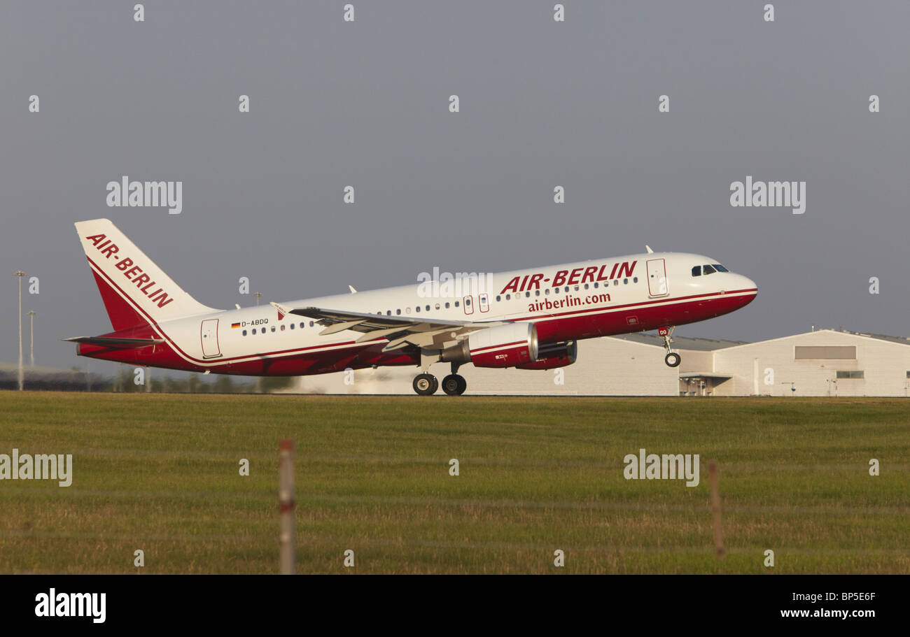 Air Berlin Airbus A320-214 landing at Stansted Airport, Essex, England, United Kingdom - Stock Image
